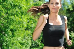 Free Young Woman Running In Green Park Royalty Free Stock Images - 10539719