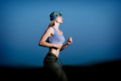 Young Woman Running In The Dark Royalty Free Stock Images