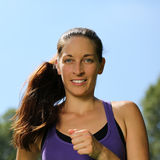Young woman running or jogging workout in a park Royalty Free Stock Photos