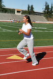 Young Woman Running Laps Stock Image