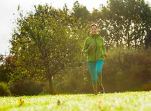 Young woman running and listening to music. Stock Images