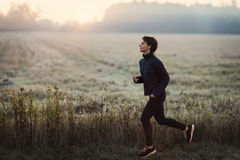 Young woman running in the morning Royalty Free Stock Photo