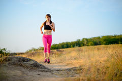 Young Woman Running on the Morning Trail. Active Lifestyle Concept. Royalty Free Stock Photos