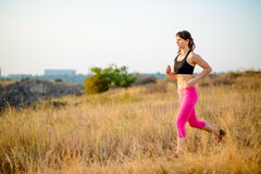 Young Woman Running on the Morning Trail. Active Lifestyle Concept. Royalty Free Stock Images