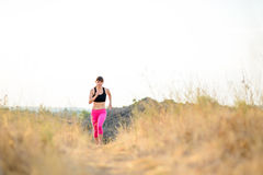 Young Woman Running on the Morning Trail. Active Lifestyle Concept. Royalty Free Stock Image