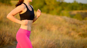 Young Woman Running on the Morning Trail. Active Lifestyle Concept. Royalty Free Stock Photography