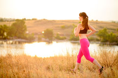 Young Woman Running on the Morning Trail. Active Lifestyle Concept. Stock Photography