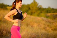 Young Woman Running on the Morning Trail. Active Lifestyle Concept. Royalty Free Stock Photo