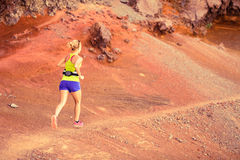 Young woman running in mountains summer sunset Stock Photo