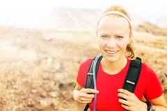 Young woman running in mountains on winter fall sunny day Royalty Free Stock Photos