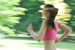 Young woman running outdoor - motion blurr Stock Photos