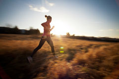 Young woman running outdoors stock photos