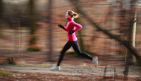 Young woman running outdoors Royalty Free Stock Image