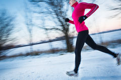 Young woman running outdoors Royalty Free Stock Images