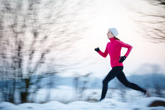 Young woman running outdoors Stock Photography