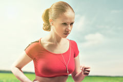 Young Woman Running Outdoors Stock Images