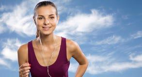 Young woman running outdoors. Young beautiful woman running outdoors Stock Photography