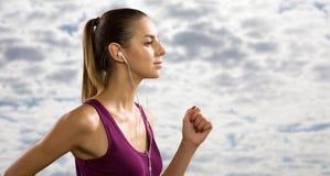 Young woman running outdoors. Young beautiful woman running outdoors Stock Images