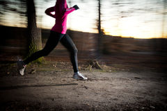 Young woman running outdoors in a city park Royalty Free Stock Photos