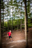 Young woman running outdoors in a forest Royalty Free Stock Photo