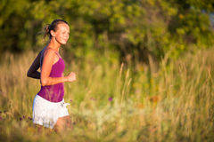 Young woman running outdoors Royalty Free Stock Photos