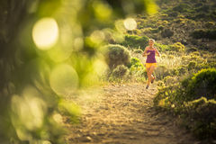 Young woman running outdoors Stock Image