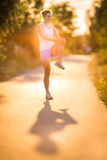 Young woman running outdoors on a lovely sunny summer evening Royalty Free Stock Images