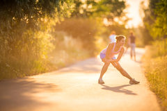 Young woman running outdoors on a lovely sunny summer evening Royalty Free Stock Image