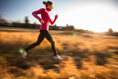 Young woman running outdoors Stock Photos