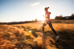 Young woman running outdoors Stock Photo