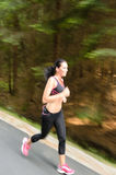 Young woman running outdoors motion blur Royalty Free Stock Image