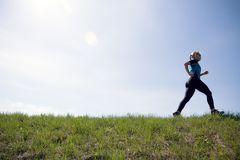 Young woman running outdoors, silhouette Stock Photo