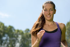 Young woman running outdoors training for marathon run Royalty Free Stock Images