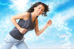 Young woman running outside Royalty Free Stock Photo
