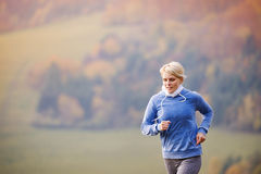 Young woman running Stock Photos