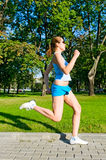 Young woman running in the park royalty free stock photography