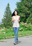 Young woman running in park Royalty Free Stock Photography
