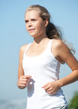 Young woman running in park Royalty Free Stock Photo