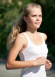 Young woman running in park Stock Images