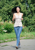 Young woman running in park Royalty Free Stock Images