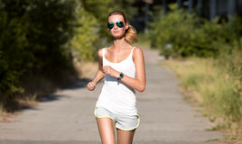 Young Woman Running. In Park Royalty Free Stock Image
