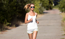 Young Woman Running. In Park Royalty Free Stock Photo