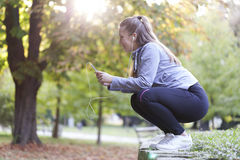 Young woman running in the park Stock Image