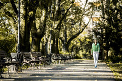Young woman running in the park Royalty Free Stock Images