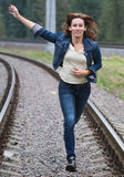 Young woman running railway Stock Photos