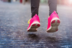 Young woman running in rainy weather Royalty Free Stock Photo