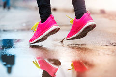 Young woman running in rainy weather Royalty Free Stock Images