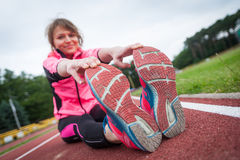 Young woman before running. She is ready to running Royalty Free Stock Images