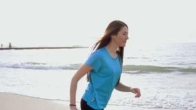 A young woman running at sea beach sunrise stock video footage