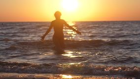 Young woman running into the sea. Summer woman beach freedom happy concept. Free during holidays vacation travel. slow. Summer woman beach freedom happy concept stock video footage